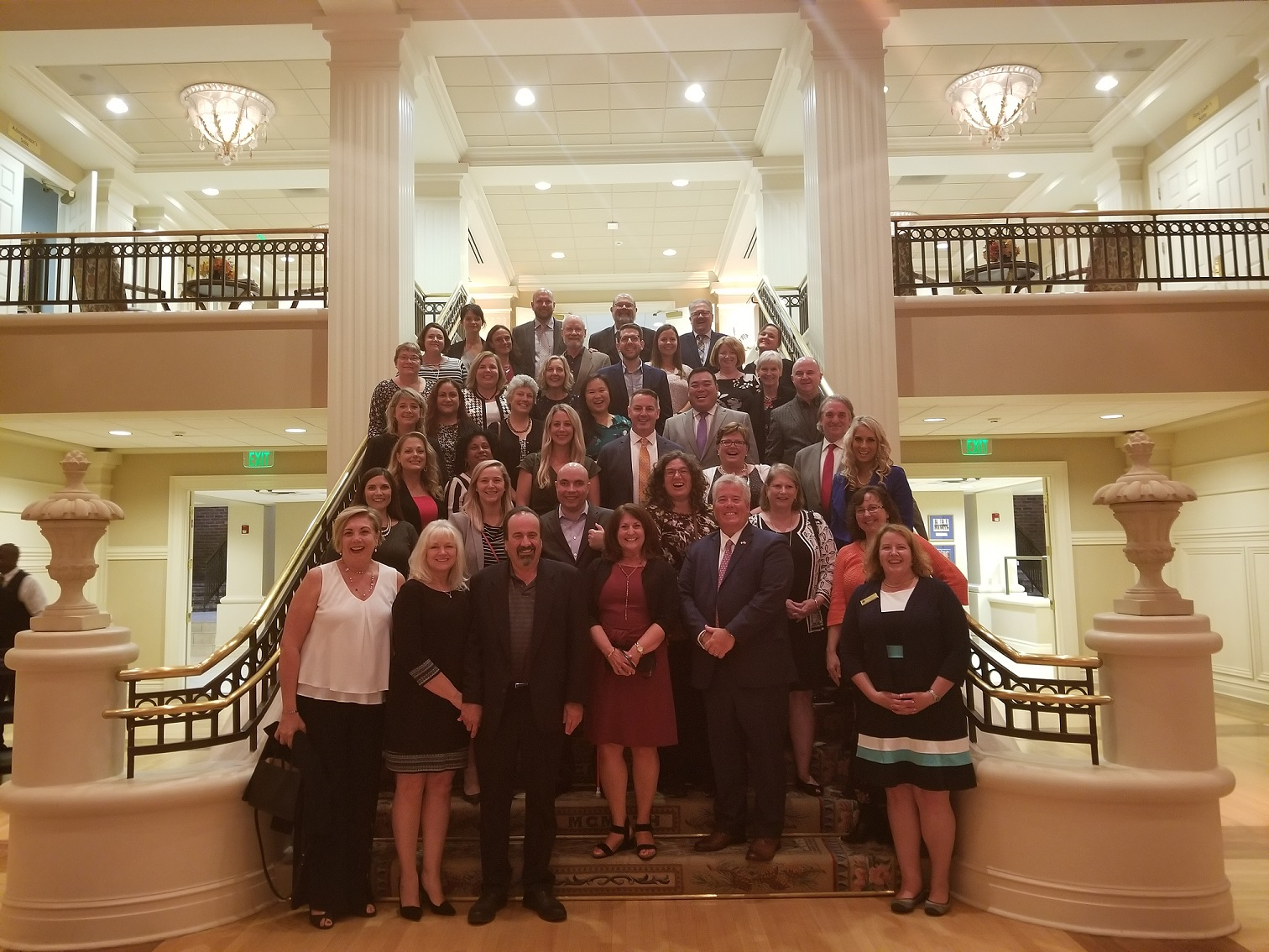 Council Executive Directors gather for a picture on steps at the Governor's Mansion in Little Rock, AR