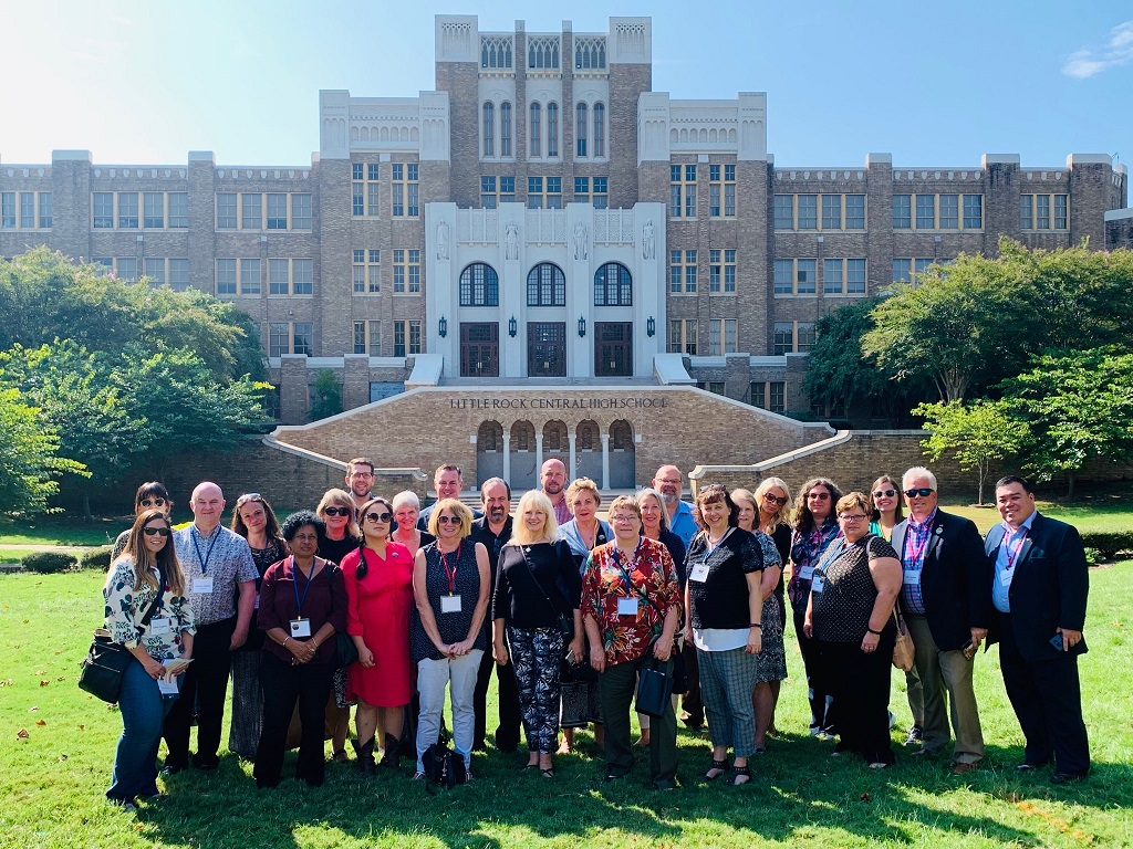 Executive Directors gathered in front of the Little Rock Central High School in Arkansas